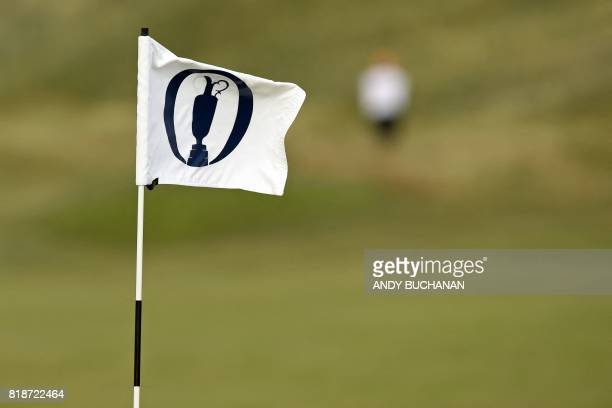 A flag flutters in the breeze during practice at Royal Birkdale golf course near Southport in north west England on July 19 ahead of the 146th Open...