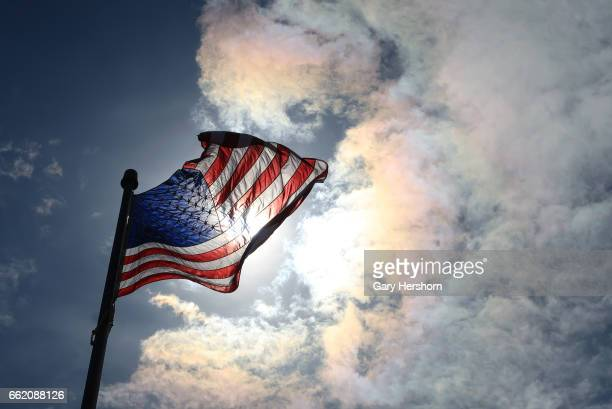 USA flag flutters in the wind above a 9/11 memorial at Mt Mitchill on March 30 in Atlantic Highlands NJ