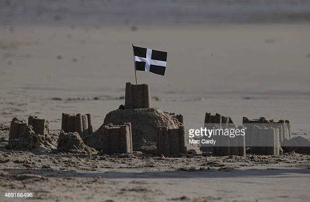 A flag flutters over a sandcastle at Sennen Cove on April 9 2015 in Cornwall England Prime Minister David Cameron has said that the six seats in the...