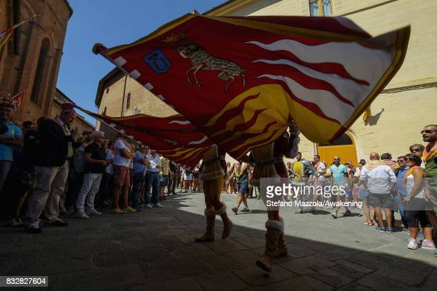 Flag flyers take part at the cortege ahead of today's Palio on August 16 2017 in Siena Italy The Palio is the most famous event in Siena and is a...
