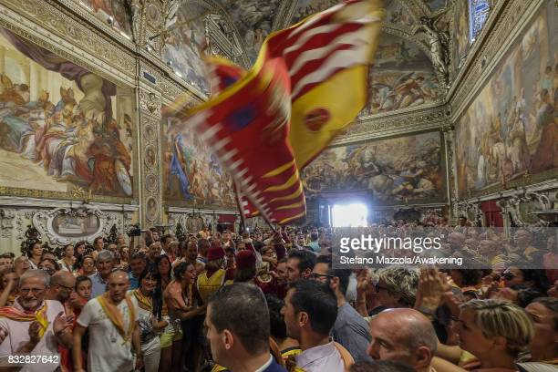 Flag flyers take part at the cortege that arrive at the church for the blessing ahead of today's Palio on August 16 2017 in Siena Italy The Palio is...