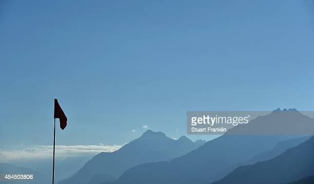 A flag flys infron of the Alps prior to the start of the Omega European Masters at CranssurSierre Golf Club on September 2 2014 in CransMontana...