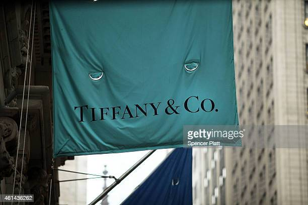 A flag for a Tiffany Co store hangs along Wall Street in Manhattan on January 12 2015 in New York City Shares in the luxury jewelry chain fell on...