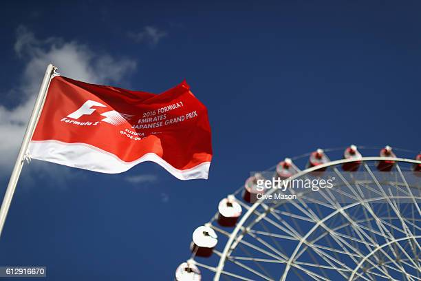 A flag for the Japanese Grand Prix and big wheel at the circuit during previews ahead of the Formula One Grand Prix of Japan at Suzuka Circuit on...