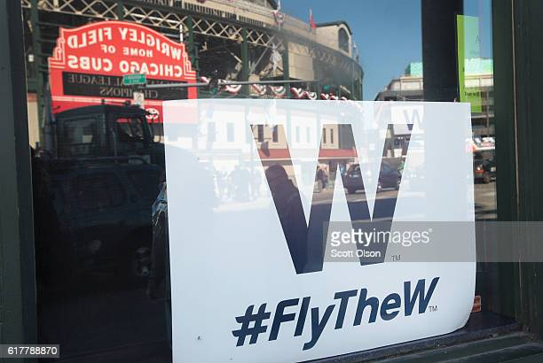 A 'W' flag hangs in the window of a bar across from Wrigley Field the home of the Chicago Cubs on October 24 2016 in Chicago Illinois The Cubs will...