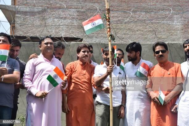 Flag hoisting done at BJP Headquarter Jawaharnagar Srinagar on the eve of 71st Independence Day After Flag Hoisting and National Anthem sweets were...