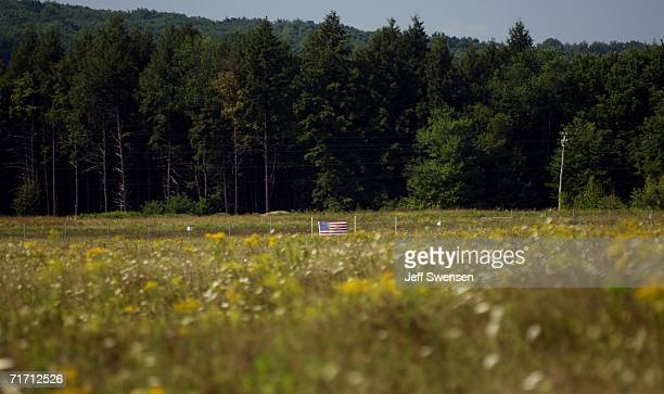 A flag is attached to the fence that closes off the Flight 93 crash site which is closed to visitors who may view it from the memorial site August 24...