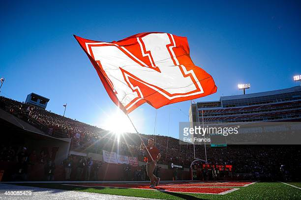 A flag is displayed after the Nebraska Cornhuskers score against the Michigan State Spartans during their game at Memorial Stadium on November 16...