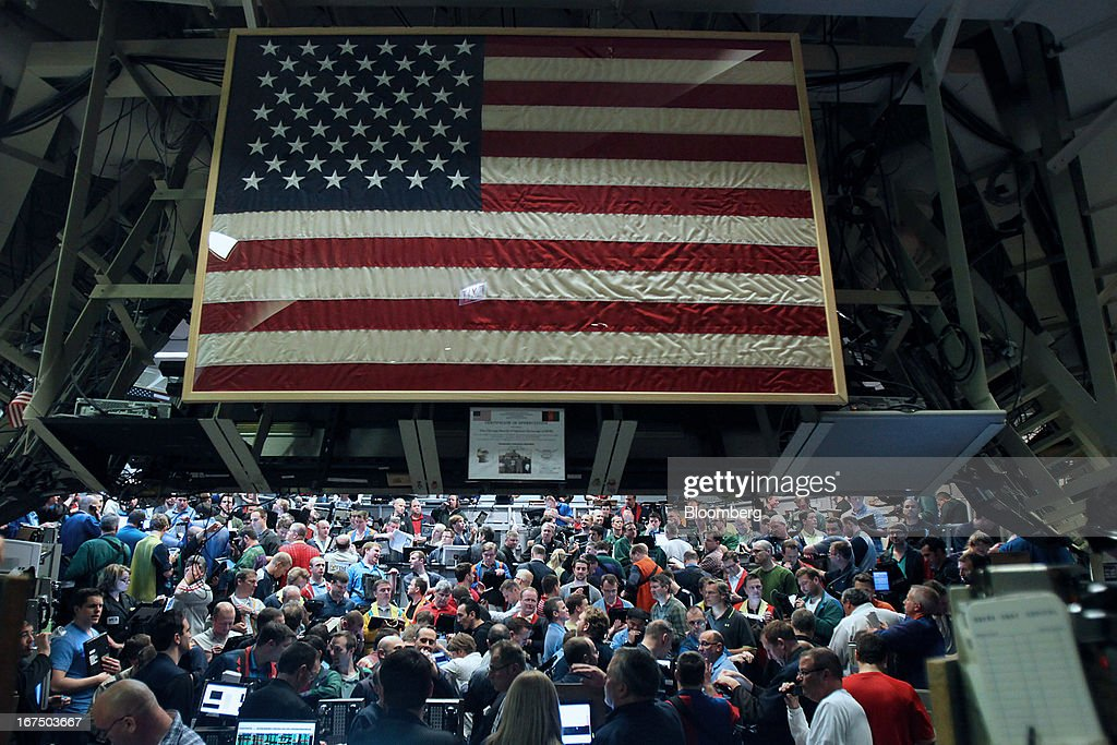 A U.S. flag is displayed as traders work on the floor of the Chicago Board Options Exchange (CBOE) in Chicago, Illinois, U.S., on Thursday, April, 25, 2013. The CBOE opened for trading three-and-a-half hours late today after a software malfunction shut the derivatives market as its top executives were away at an industry event in Las Vegas. Photographer: Tim Boyle/Bloomberg via Getty Images