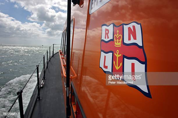 RNLI flag is displayed on the side of an experimental fast Carriage Lifeboat off Poole Harbour on July 6 2007 in Dorset England The Royal National...