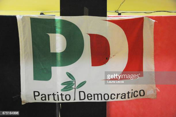 flag is displayed while former Italian Prime Minister and PD secretary Matteo Renzi casts his vote for Democratic Party leadership primaries on April...