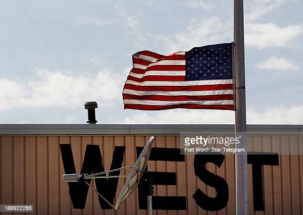 A flag is flown at half staff in West Texas near the scene of the fertilizer plant that exploded Wednesday night in in the town of 28000 on Thursday...