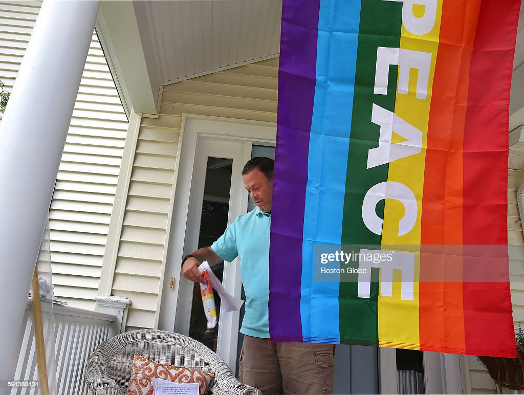 A flag is hung from the front of Dennis Gaughan's home in Natick Mass Aug 22 in support of their neighbors Married couple Lauri and Cari Ryding...
