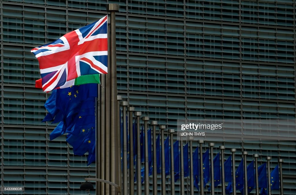 A UK flag is pictured at the EU headquarters in Brussels on June 28, 2016. / AFP / JOHN