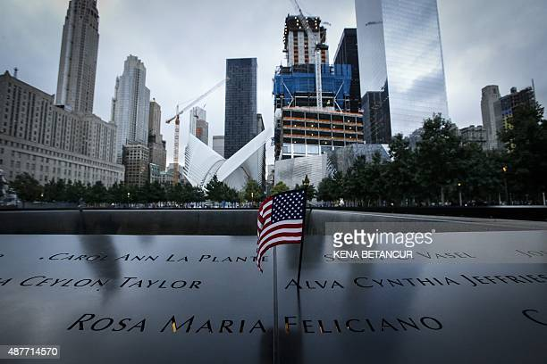 A US flag is placed on the 9/11 memorial before the ceremony to commemorate the 14th Anniversary of the terrorist attacks on September 11 2015 in New...