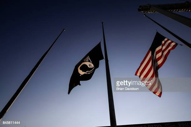 Flag is raised during pregame ceremonials of Armed Forces Night before the Chicago White Sox took on the Kansas City Royals at Kauffman Stadium on...