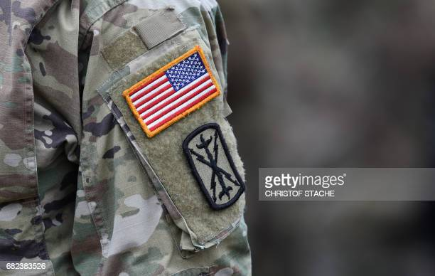 A US flag is seen at a soldier uniform during the exercise 'Strong Europe Tank Challenge 2017' at the exercise area in Grafenwoehr near Eschenbach...
