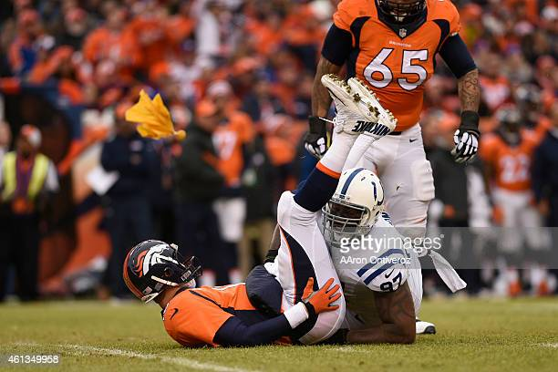 A flag is thrown as Arthur Jones of the Indianapolis Colts hits Peyton Manning of the Denver Broncos after he throws the ball in the first quarter...
