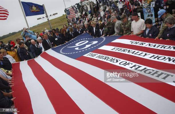 A flag is unfolded at a memorial site on the 5th anniversary of the September 11 2001 attacks where United Flight 93 crashed into a field in...