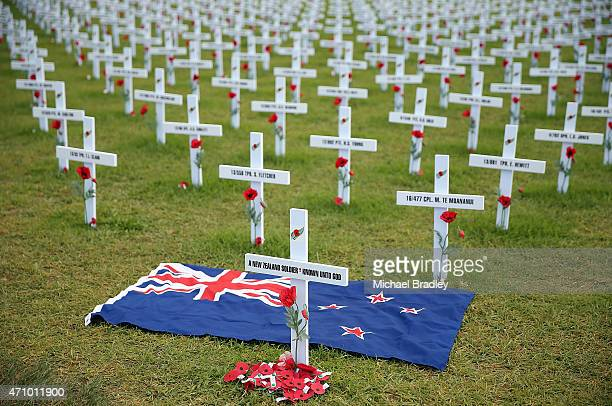 A flag lies amounst crosses as Veterans families officials and members of the Armed Services attend the Civic Service as part of Anzac Day at the...
