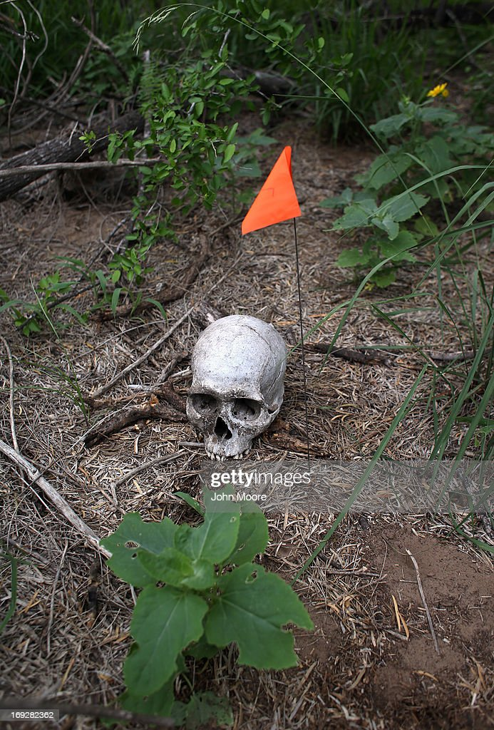 A flag marks the spot where the skull of a suspected undocumented immigrant was found by the U.S. Border Patrol on a ranch on May 22, 2013 in Falfurrias, Brooks County, Texas. In Brooks County alone, at least 129 immigrants perished in 2012, most of dehydration while making the long crossing from Mexico. Teams from Baylor University and the University of Indianapolis are exhuming the bodies of more than 50 immigrants who died, mostly from heat exhaustion, while crossing illegally from Mexico into the United States. The bodies will be examined and cross checked with DNA sent from Mexico and Central American countries, with the goal of reuniting the remains with families.