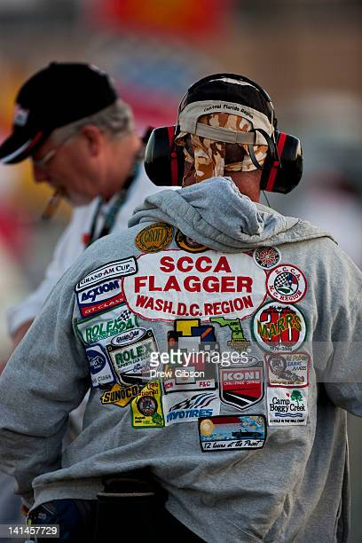 A flag marshal trackside wearing a hoodie bearing many embroider badges during the 2012 World Endurance Championship12 Hours Of Sebring at Sebring...