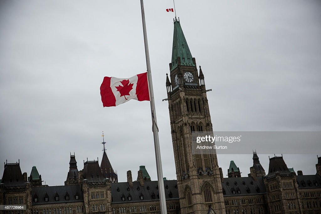 A flag next to the Canadian Parliament Building is flown at half staff one day after Cpl Nathan Cirillo of the Canadian Army Reserves was killed...