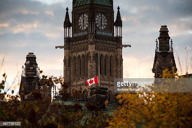 A flag next to the Canadian Parliament Building is flown at halfstaff one day after Cpl Nathan Cirillo of the Canadian Army Reserves was killed while...