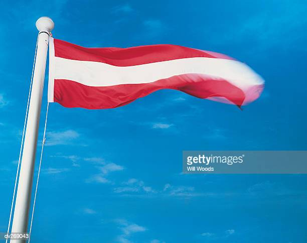 Flag of Austria on flagpole waving in wind