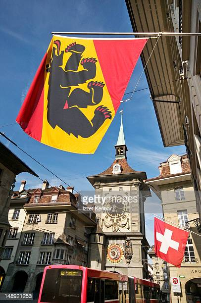 Flag of Bern Canton and Zytglogge medieval clock tower.