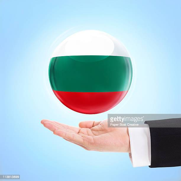 Flag of Bulgaria being supported by a hand