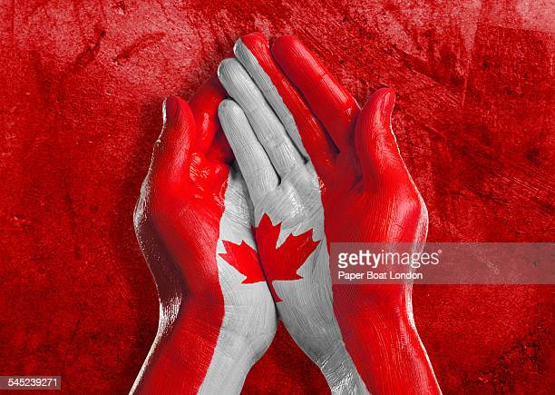 Flag of Canada painted on two hands together