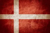 flag of Denmark or Danish banner on stone background
