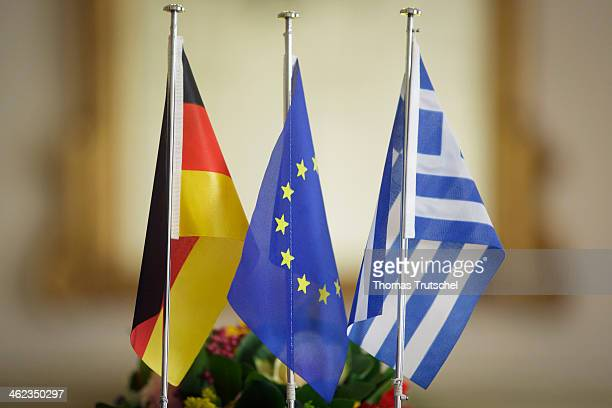 Flag of Europe Greek flag and German flag standing on a table on January 09 in Athens Greece
