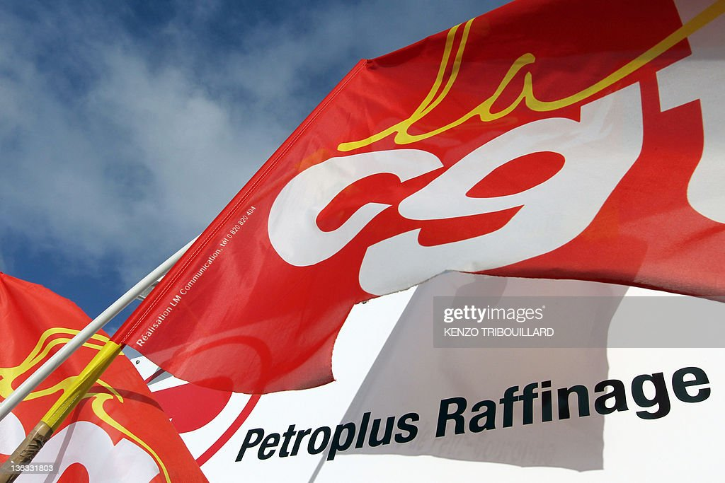 A flag of French union CGT is pictured in front of the oil refinery of Swiss firm Petroplus in Petit-Couronne, near Rouen, northwestern France, on January 02, 2012, during a general assembly of the employees. Petroplus, Europe's largest independent oil refiner, began today the temporary economic shutdown of this refinery followed their announcement that banks had frozen about $1 billion in uncommitted credit lines deemed 'critical' to maintain its operations.