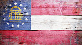 Flag of the U.S. state of Georgia painted on grungy wooden background