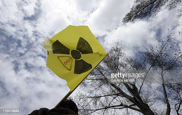 A flag of green party is seen as members walk in the street of the western city of Nantes on March 15 2010 demanding an end to nuclear policy in the...