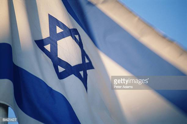 Flag of Israel with Star of David emblem, low angle view