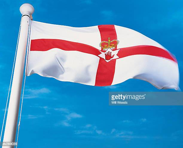 Flag of Northern Ireland waving in the wind on flagpole