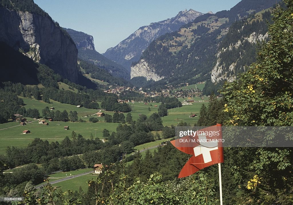 Flag of Switzerland, near the Trummelbach falls, Interlaken, Switzerland.