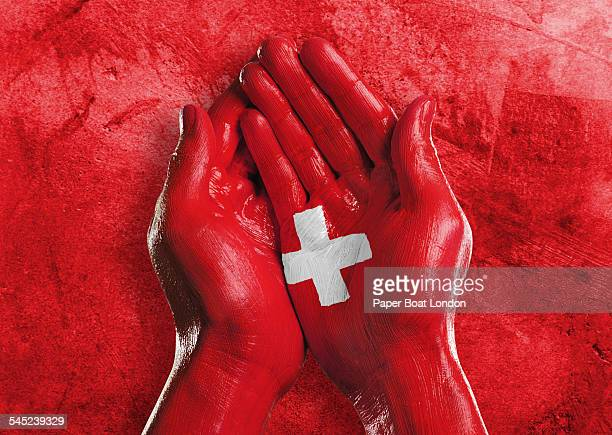 Flag of Switzerland painted on two hands