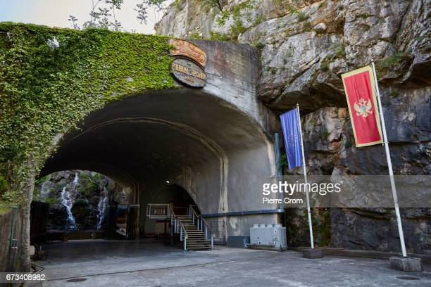 A flag of the European Union and a national Montenegrin flag are seen at the entrance of a wine cellar in the stateowned winery Plantaze on April 26...