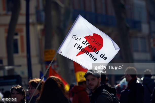A flag of the NGO Uman rights League during a march in protest against police violence after the alleged rape with a truncheon of Theo Luhaka by four...