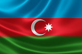 Close up of the flag of Azerbaijan on silky fabric. Azerbaijan is located at the crossroads of Southwest Asia and Southeastern Europe.