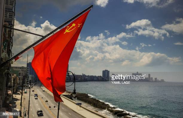 A flag of the Soviet Union flutters in the wind at the retroSoviet restaurant Nazdarovie in Havana on October 16 2017 With three decades of close...