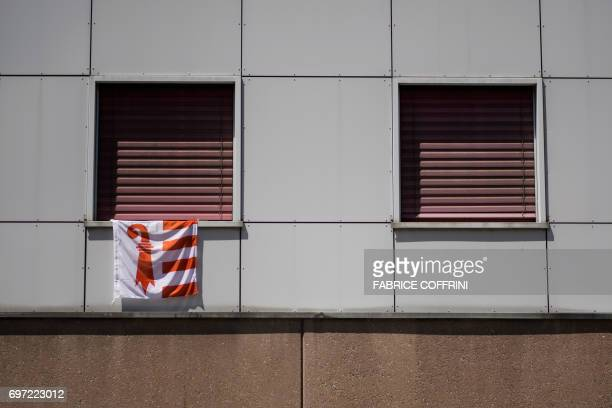 A flag of the Swiss canton Jura is pictured in front of the voting station during an historical anticipated vote on June 18 2017 in Moutier northern...