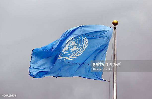 Flag of the United Nations in front of grey clouds on top of the United Nations Secretariat at the headquarters of the United Nations on September 24...