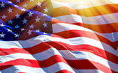 Flag of the USA with bright sunflare