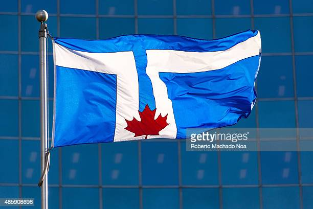 Flag of Toronto The flag displays the twin towers of the Toronto City Hall on a blue background with the red maple leaf of the Flag of Canada at its...