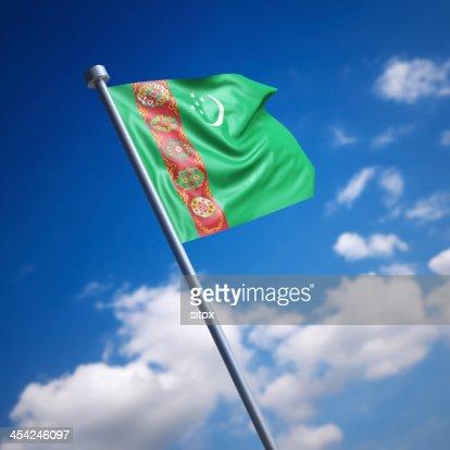 Flag of Turkmenistan against blue sky : Stock Photo